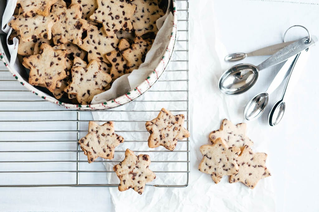 Star shaped crispy chocolate chip cookies with measuring spoon