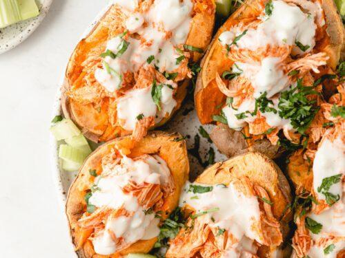 Plate of buffalo chicken stuffed sweet potatoes