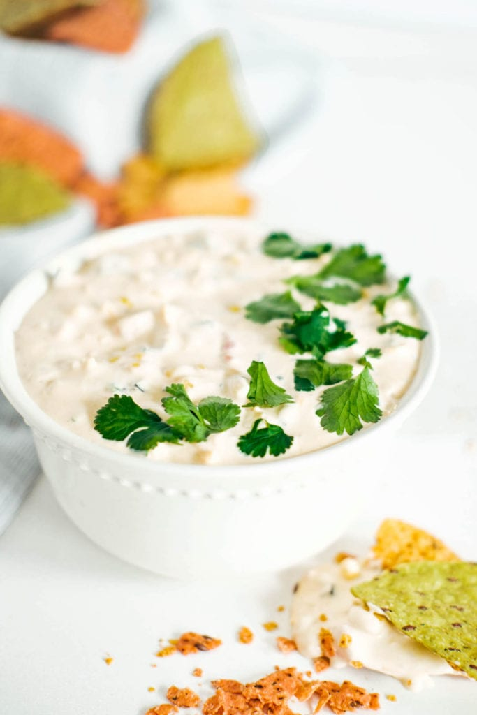 Mexican corn dip in a bowl surrounded by chips
