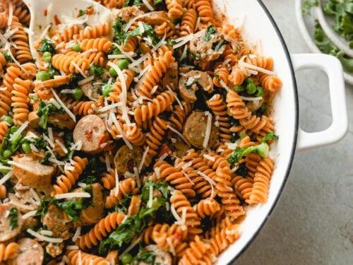 Close up of tossed veggie pesto pasta