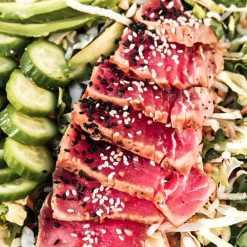 close up of ahi tuna with sesame seeds on salad