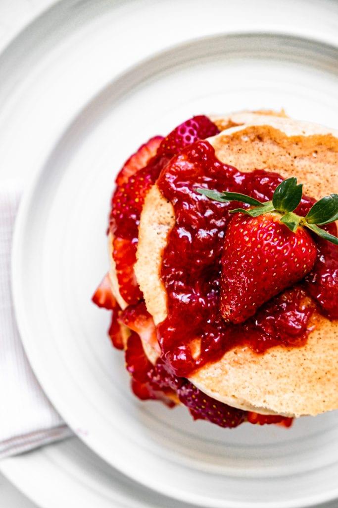 strawberry jam on pancake stack