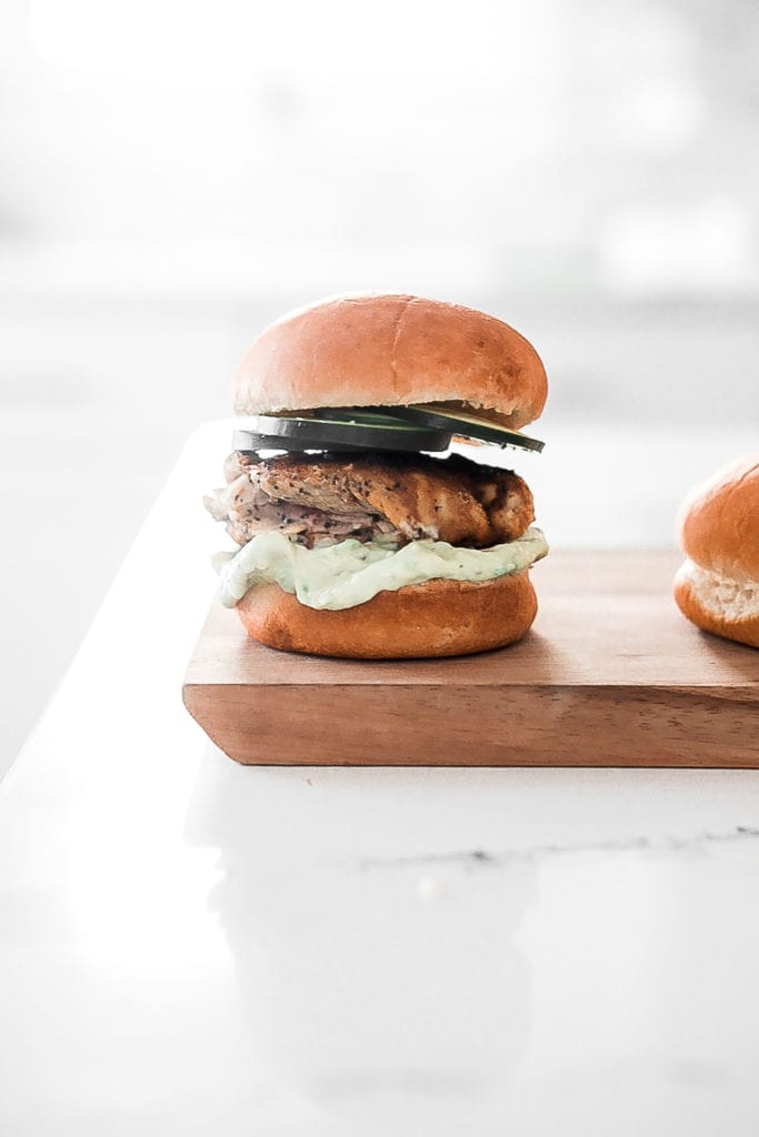 single grilled chicken slider on cutting board