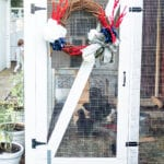 homemade wreath on chicken coop