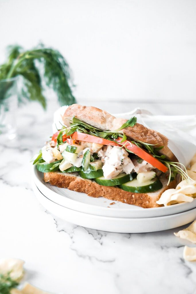 cucumber chicken salad on a sandwich wrapped in parchment