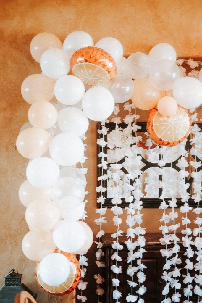 white and orange balloon garland