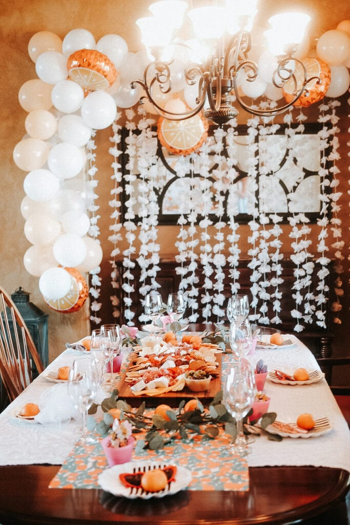 dining room table with charcuterie board and place settings