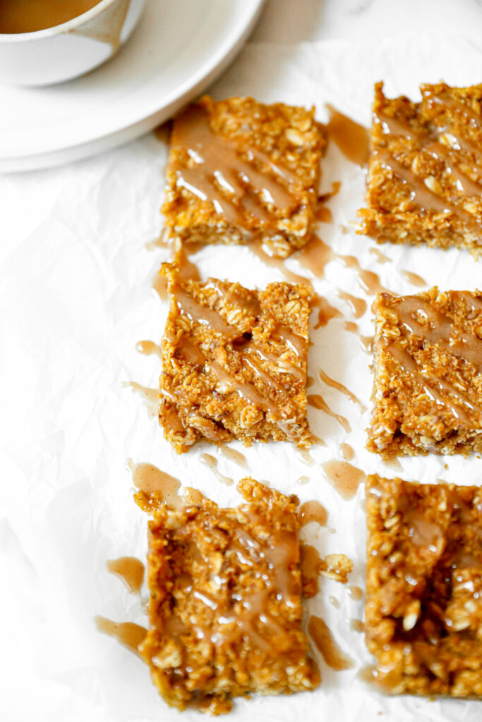 maple pumpkin oatmeal bars drizzled with a maple almond glaze