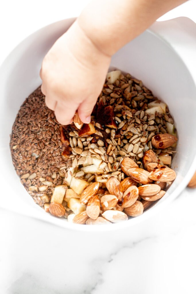 granola ingredients unmixed in a mixing bowl