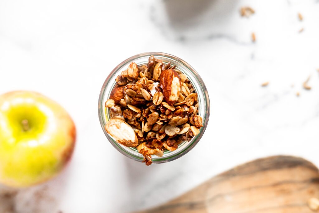 close up shot of granola in a glass jar