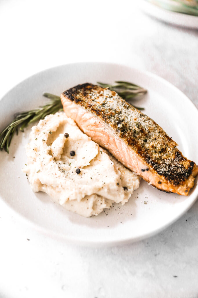 plated crispy skin salmon over mashed potatoes