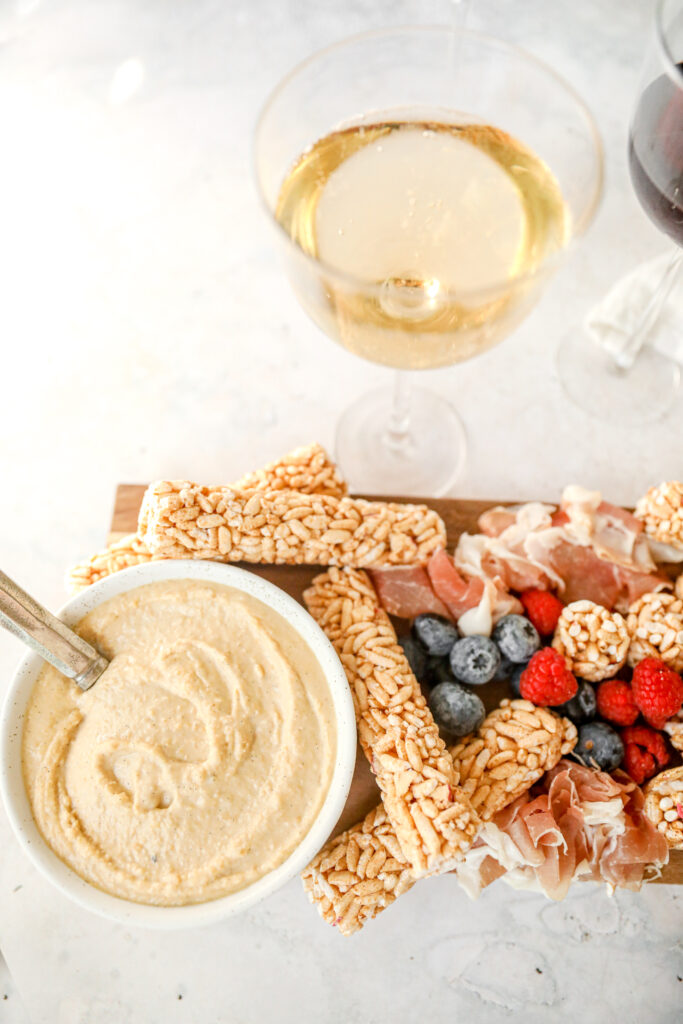 vanilla bean hummus on grazing board with white wine