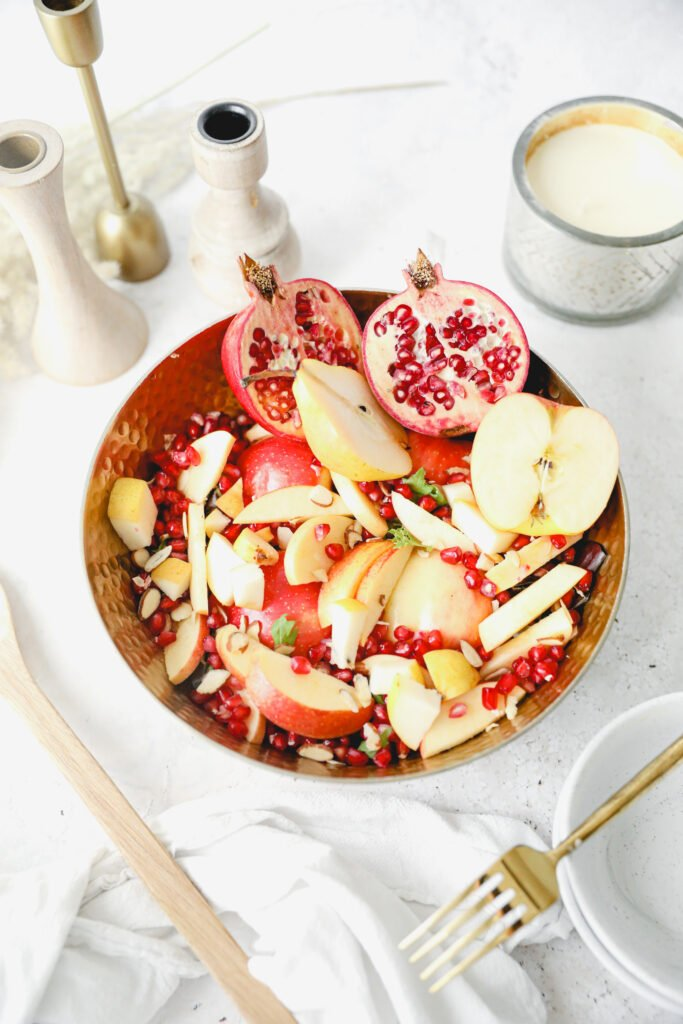 bowl of fruit salad in a gold bowl