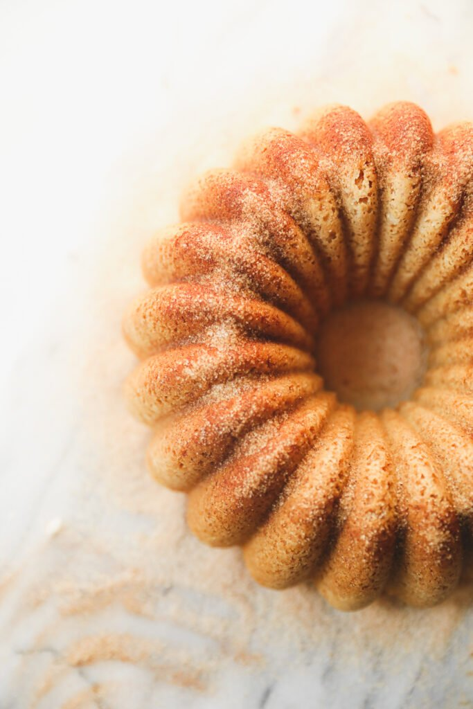 snickerdoodle Bundt Cake dusted with cinnamon sugar