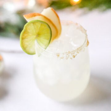 pear margarita garnished with lime and pear slices