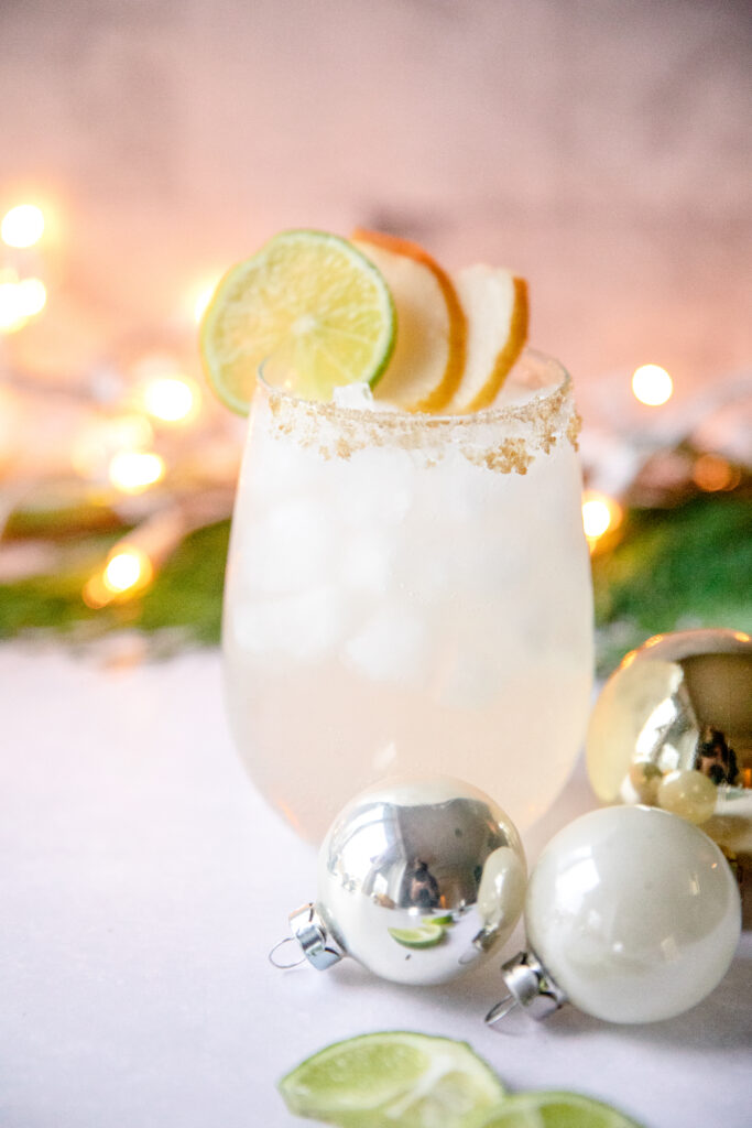 pear margarita with Christmas ornaments around it