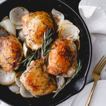 rosemary white wine chicken thighs in cast iron skillet