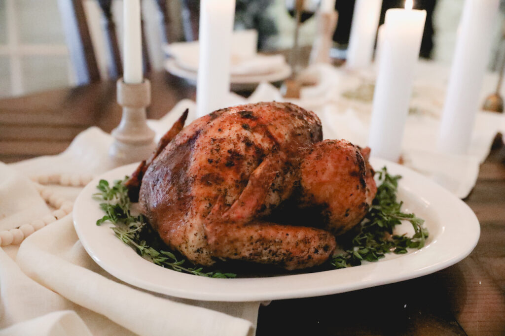thanksgiving turkey on a set table with white linen