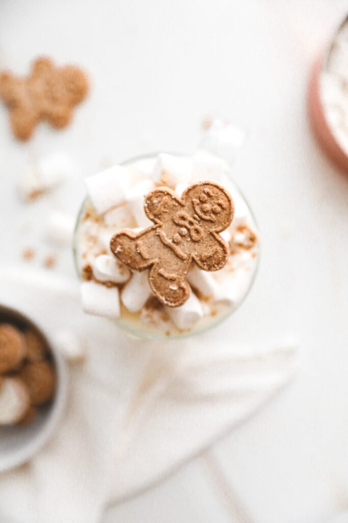 white hot chocolate topped with a gingerbread man, shot top down