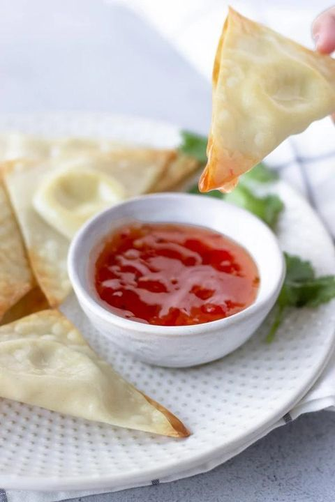 cream cheese wonton dipped in sauce