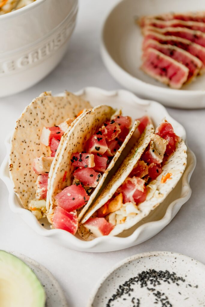 3 Ahi Tuna tacos on a white plate
