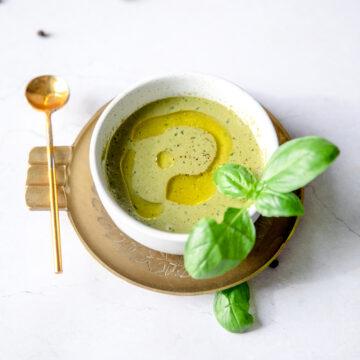 basil balsamic vinaigrette in a white bowl with tasting spoon