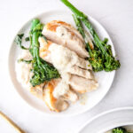 sliced chicken breast with cauliflower Alfredo and broccoli