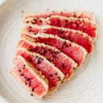 seared ahi tuna sliced and garnished with black sesame seeds