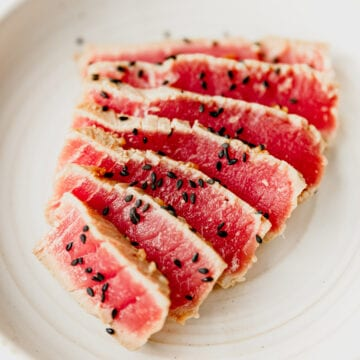 seared ahi tuna sliced and garnished with black sesame seeds