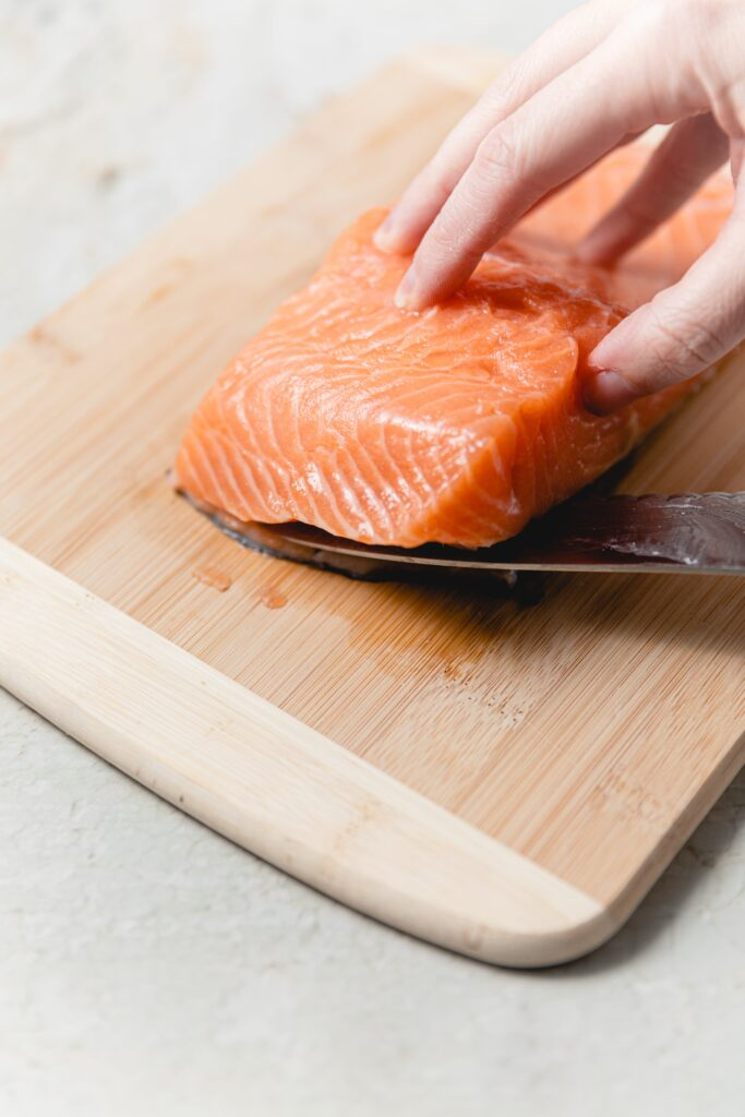 removing salmon skin with serrated knife