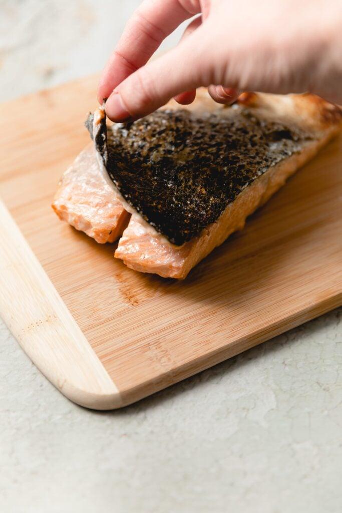 peeling off cooked salmon skin