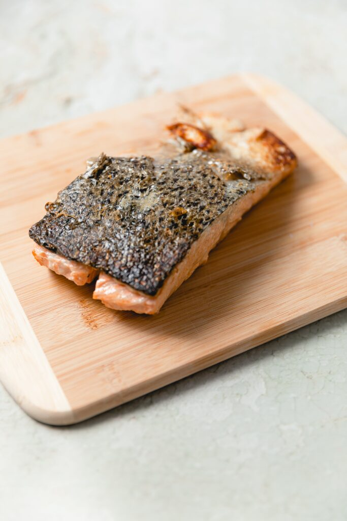cooked salmon filet with crispy skin