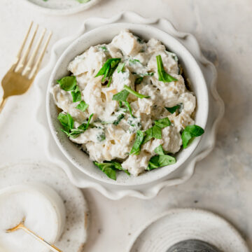 bowl of spinach artichoke chicken salad