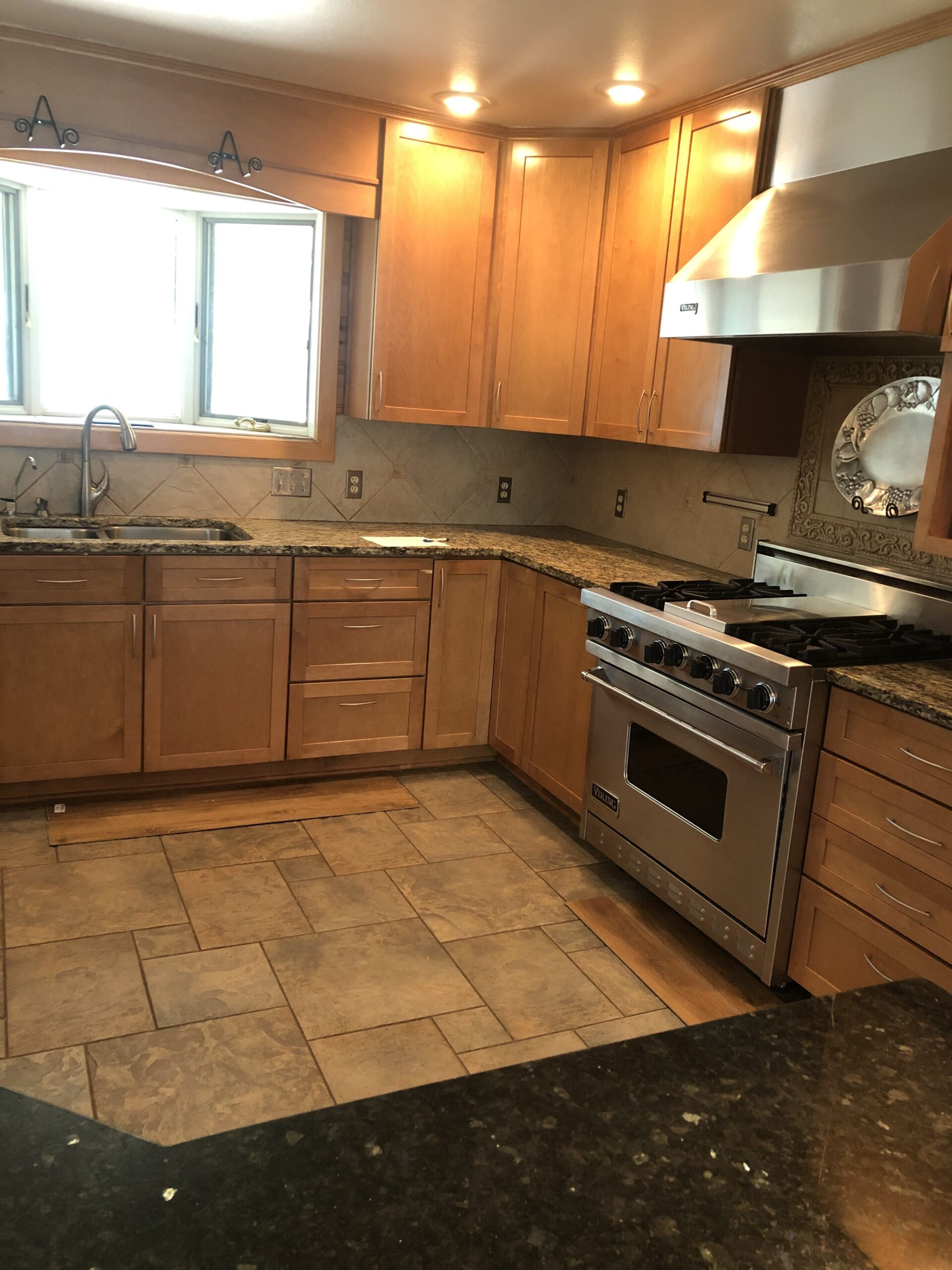 Maple cabinets and tile floor kitchen