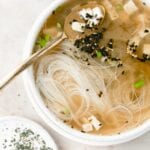 bowl of miso soup with gold spoon