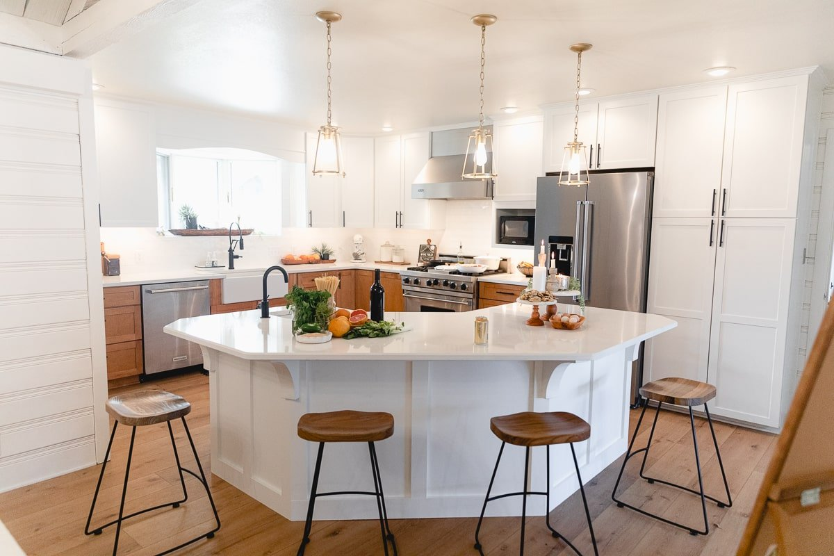 White kitchen with lower maple cabinets