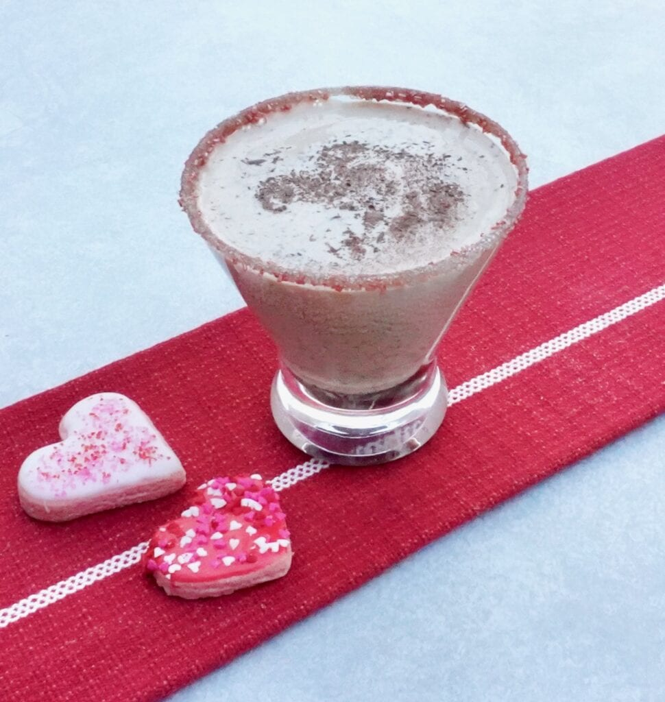 chocolate martini on a red table runner with pink hearts