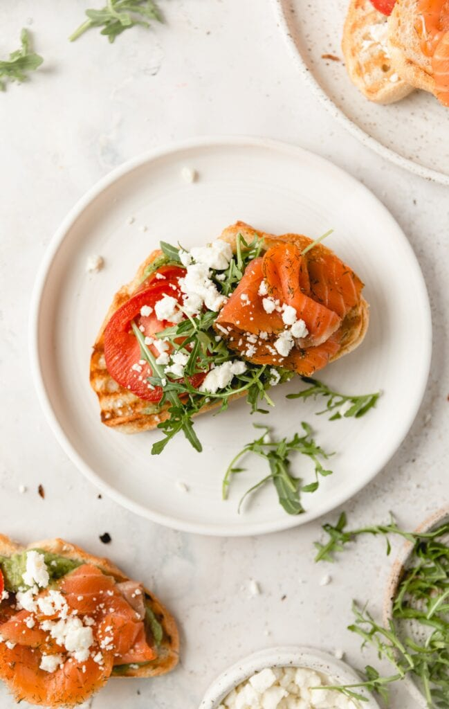 smoked salmon on toast with feta and arugula