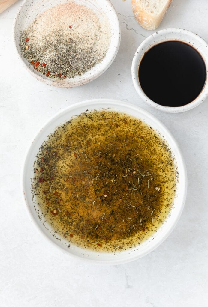 olive oil mixed with spices in a white dish