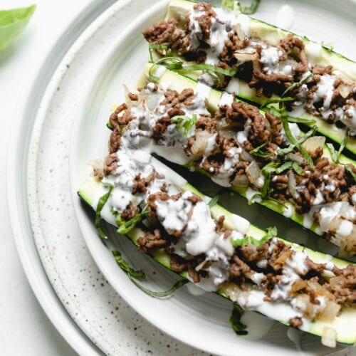 stuffed courgettes on a white plate