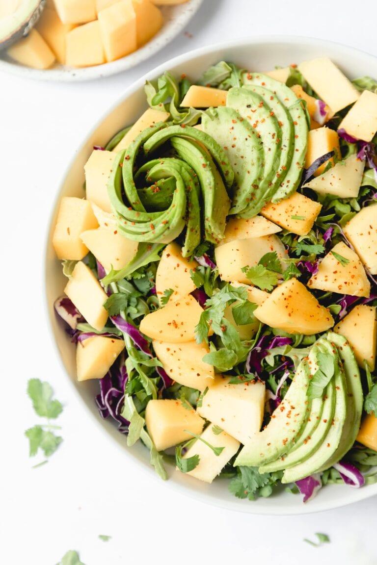 Close up photo of mango avocado salad garnished with cilantro
