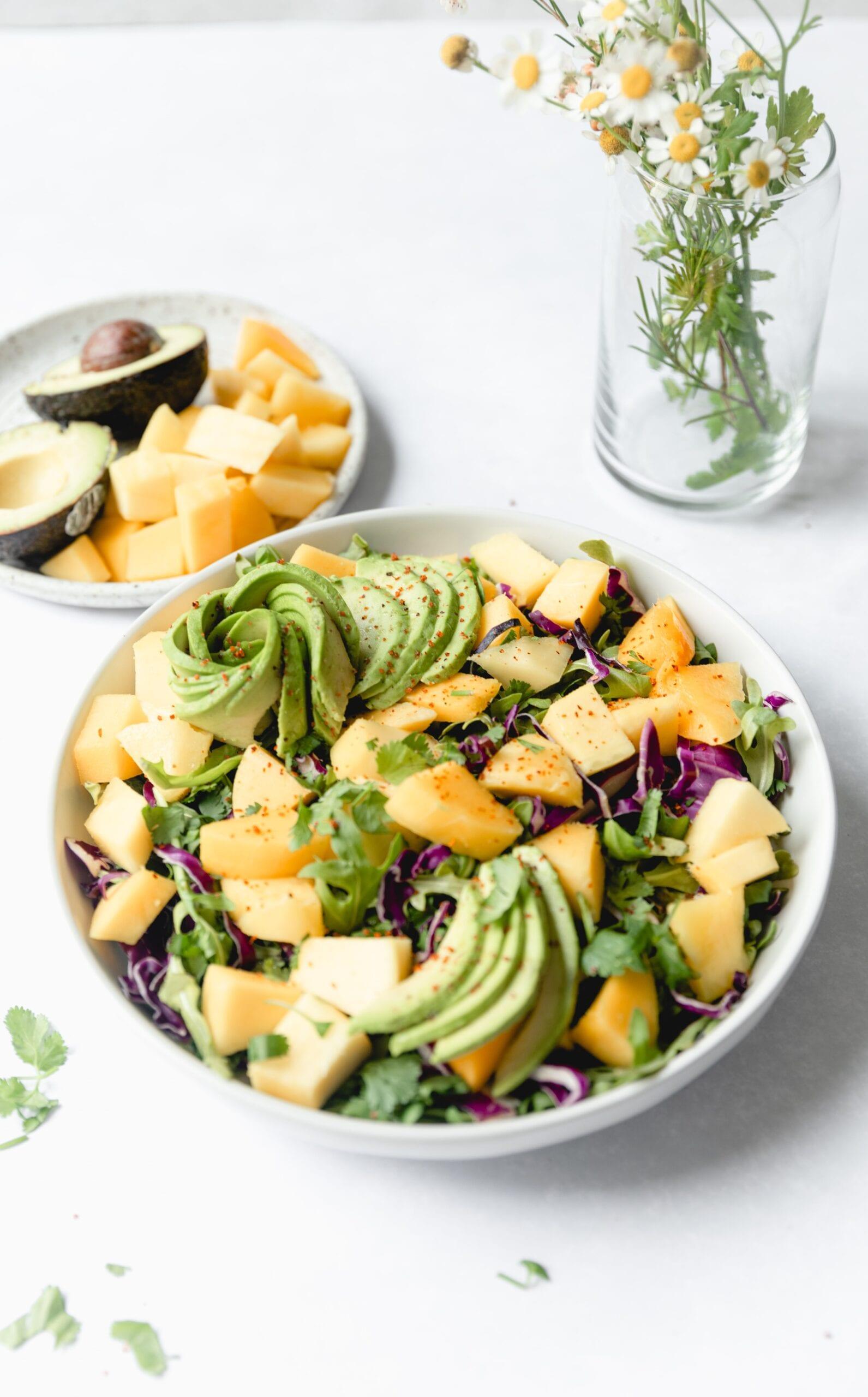 white bowl with mango salad