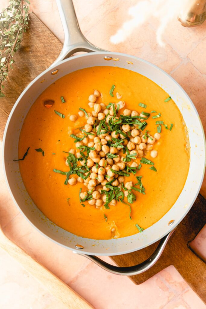 chickpeas in the butternut squash curry with cilantro garnish