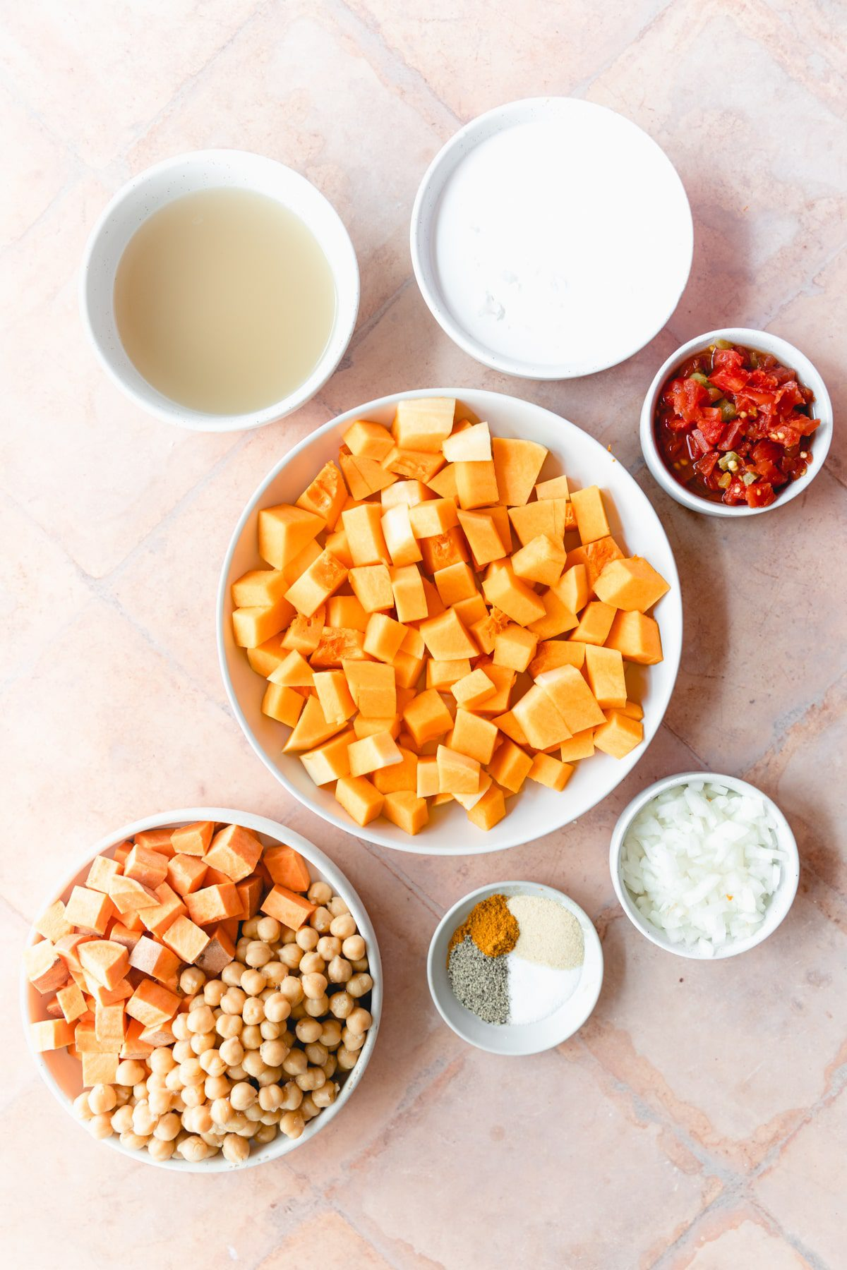 butternut squash curry ingredients in white bowls
