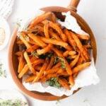 wooden bowl with crispy sweet potato fries