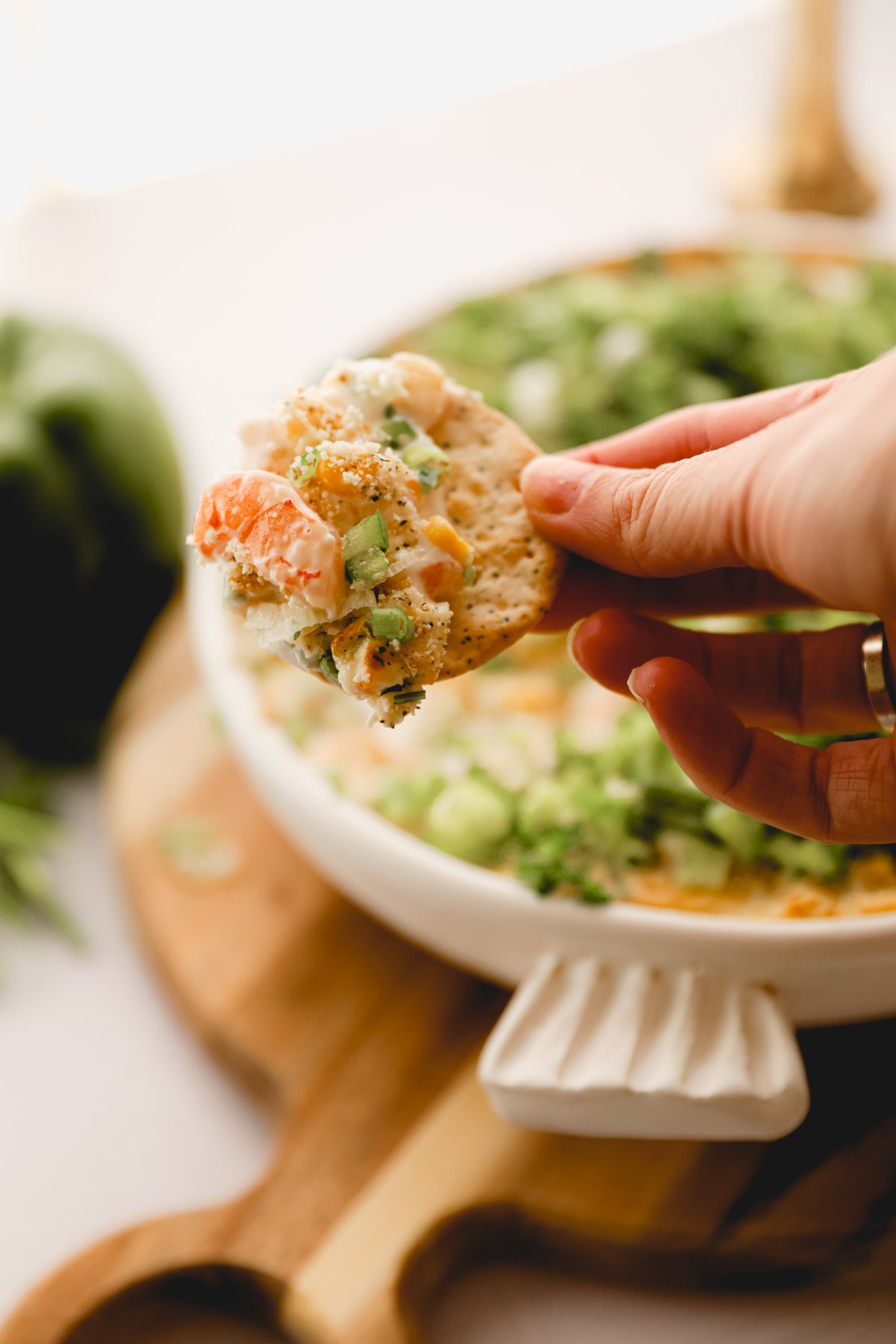 cracker scooped in creamy shrimp dip.