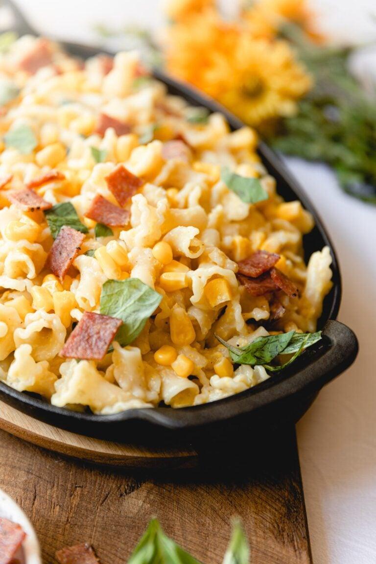corn bacon pasta in a black skillet