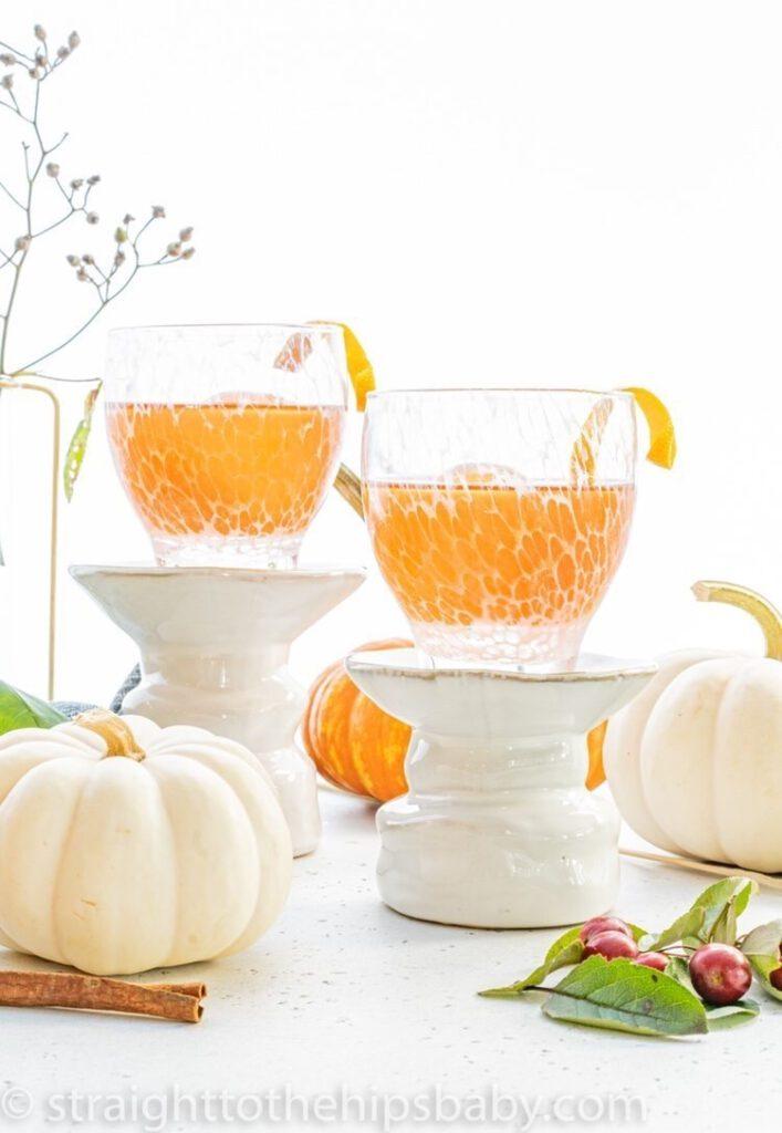 whiskey harvest shots garnished with orange peel